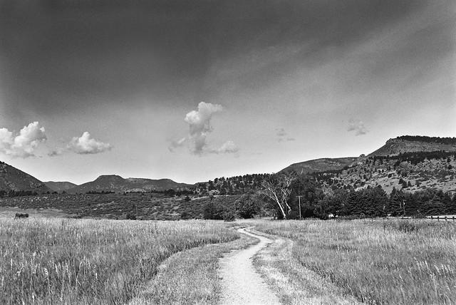Winding Path Under Western Skies