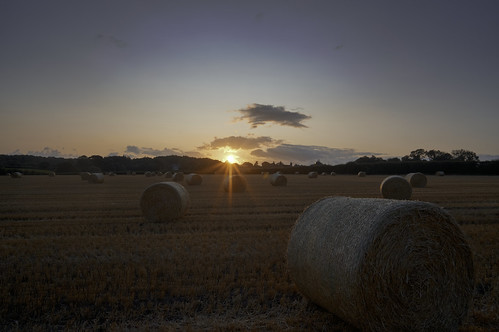 Sunset over straw bales