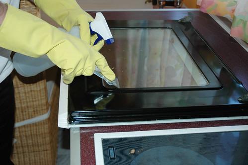 Cleaning Oven Door With Kitchen Scrape