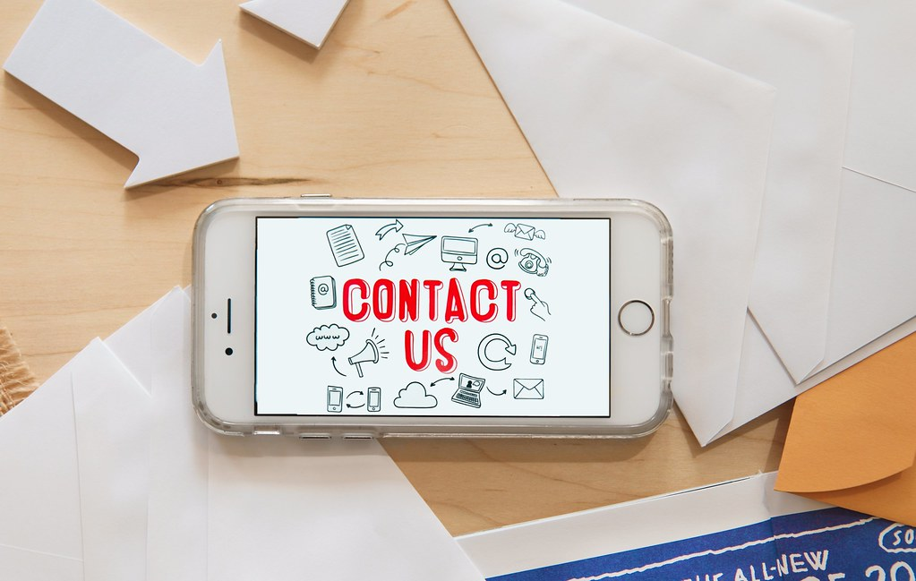 smart phone saying contact us