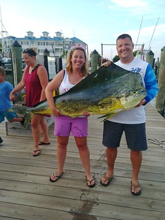 Photo of woman holding record dolphinfish she caught