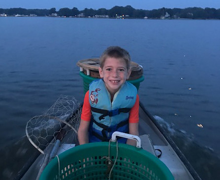 Photo of boy in boat crabbing