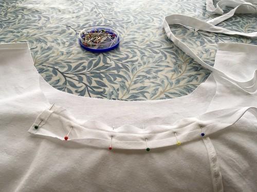 Cross over back apron