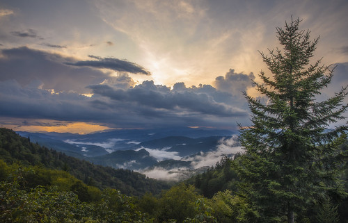 blueridgeparkway mountains greatsmokymountains nationalpark sky sunset orange glow trees nature beautiful vista scenery clouds peaceful relax summer season travel adventure fir northcarolina maggievalley cherokee qualla fog mist