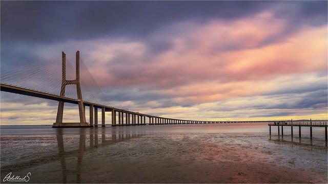 Sunset at Vasco da Gama bridge in Lisbon, Portugal