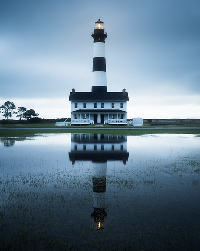 outerbanks lighthouse usa landscape seashore water hatteras light summer atlantic ocean travel scenic reflection obx view bodieisland national northcarolina bluehours