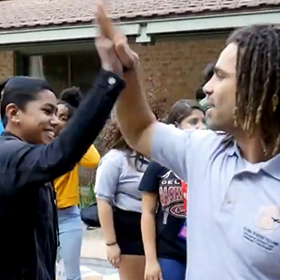 Dr. Walker and a student high-five