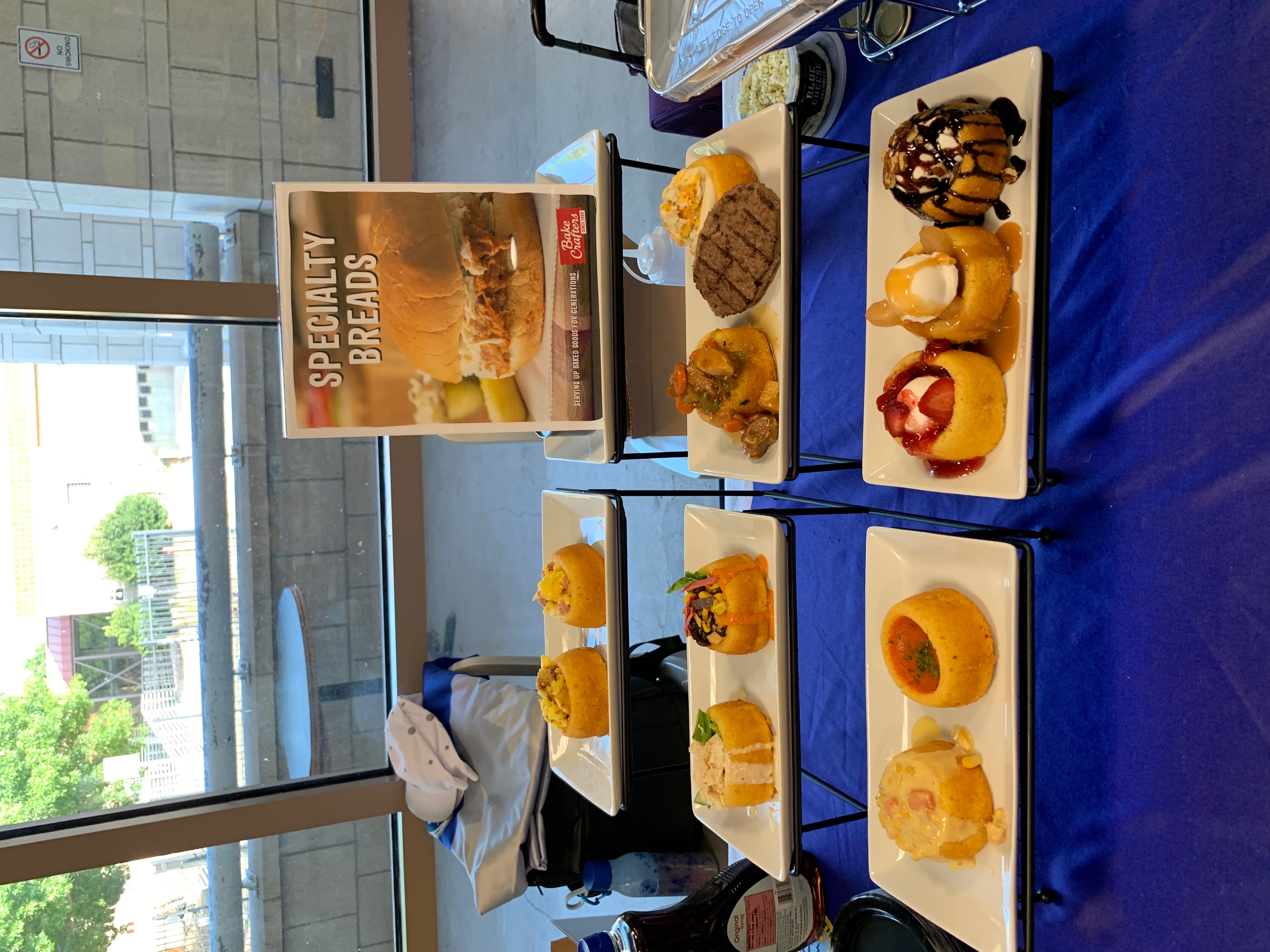 Display Samples of the Cornbread Bowls with various food products displayed in them.