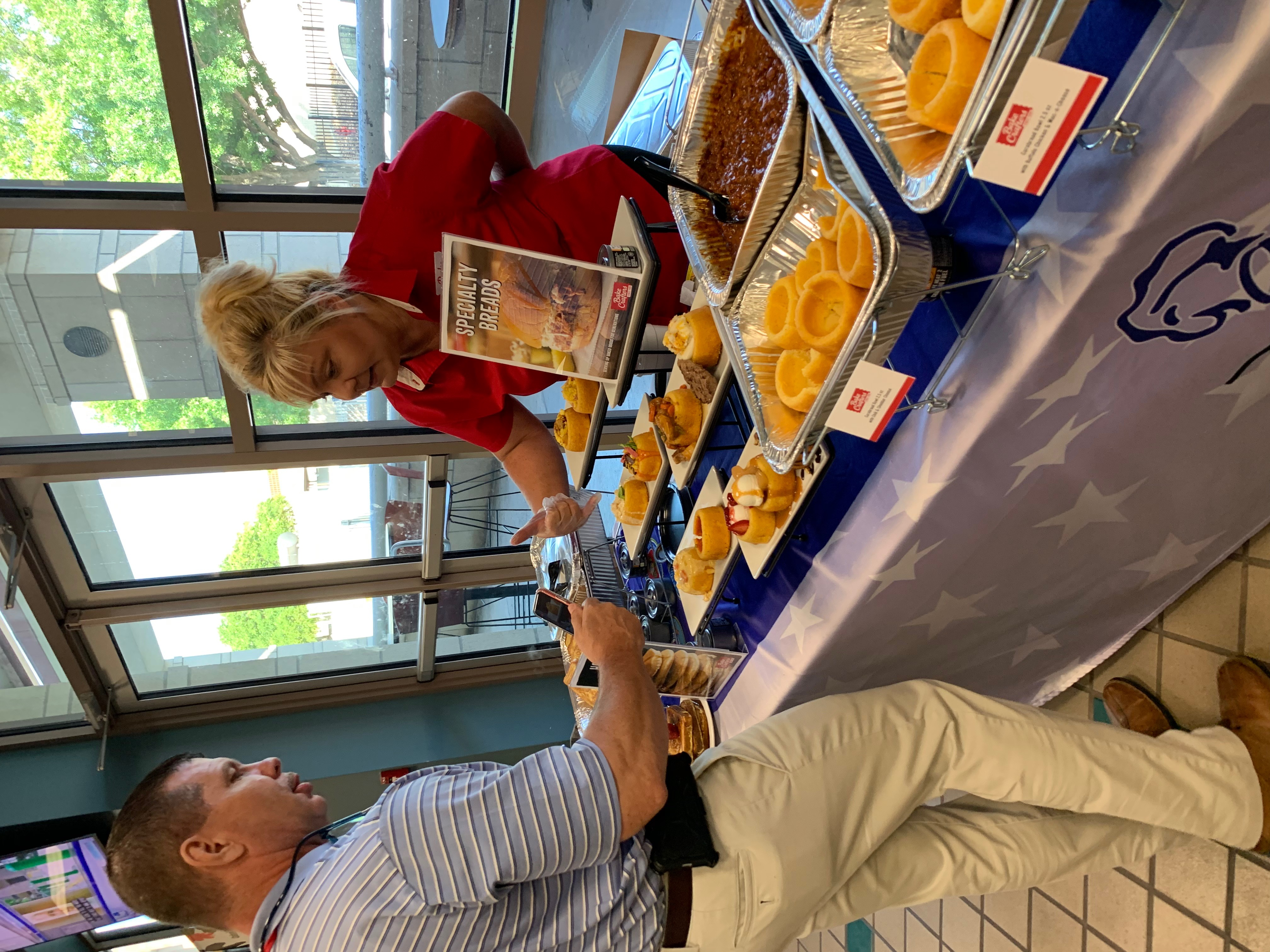 Jolynn Linder of Bake Crafters explaining the Cornbread concept and versatility of the product to Tom, customer from the Agency.