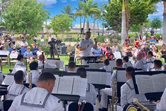 Ensign David Harbuziuk directs the U.S. Pacific Fleet Band during a history and heritage concert, Aug. 22. (National Park Service/Daniel Martinez)