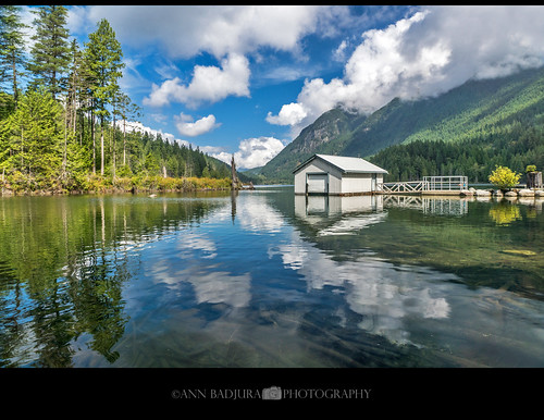 buntzenlake anmore vancouver britishcolumbia canada bc boathouse lake water calm reflections clouds 604now miss604 ctvphotos 24hrvancouver colourfulvancouver canadianbeauty iamcanadian vancitybuzz ourcanada photonewsgallery marculescueugendreamsoflightportal georgiastraight annbadjura photography landscape scenery nature pnw pacificnorthwest discoverpnw