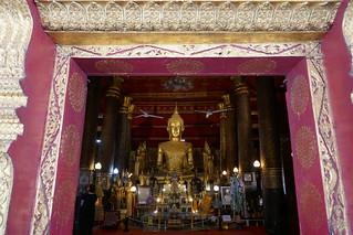 Buddha images through doorway, Wat May