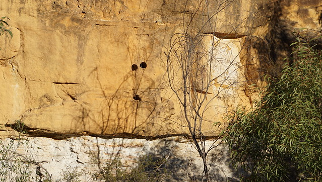 Drill holes in the sandstone cliff