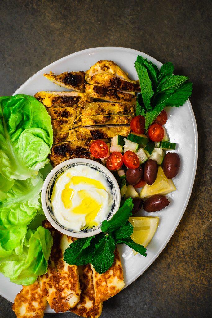 Preserved lemon chicken is marinated with tangy yogurt creating a vibrant and full flavored recipe. Wrap chicken in lettuce leaves or skewer for kabobs.