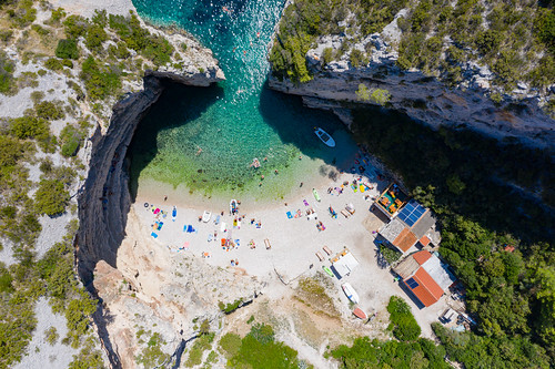 Aerial view of Stiniva Cove on Vis island in Croatia | by dronepicr