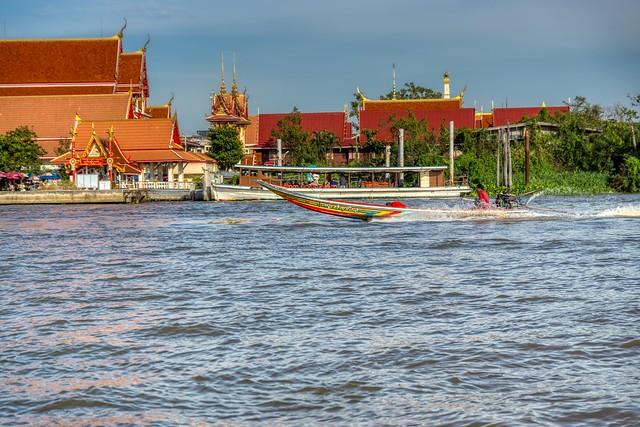 Long-tail boat on the Chao Phraya river passing Ko Kret near Bangkok, Thailand