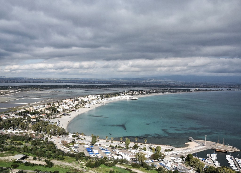 A blue aerial view of a beach landscape