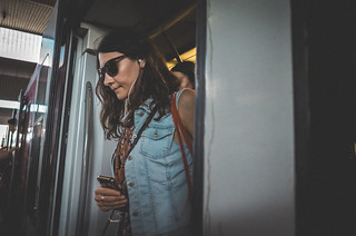 Woman with shades getting off the train