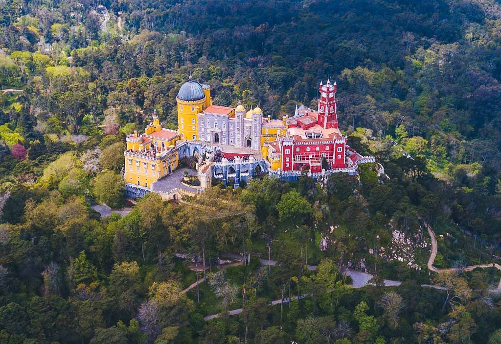 An aerial view of the yellow and red Sintra Palace