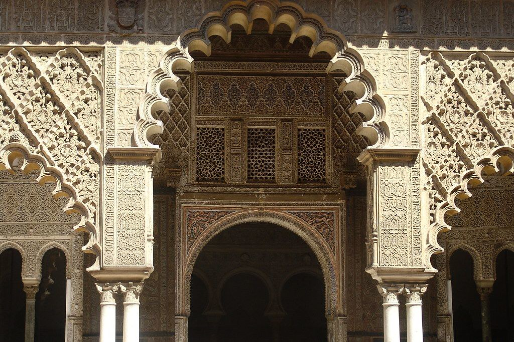 A close-up photo with architectural details of the Alcazar of Seville
