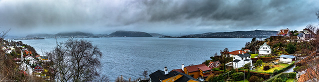Multi-photo panorama view of the harbor, Fijord Norvegien and Askoy Bridge in the distance from Bergen, Norway- 5