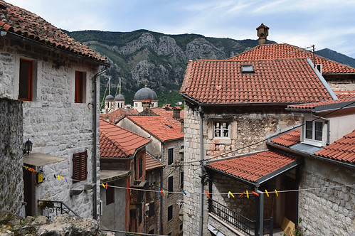 buildings architecture rooftops laundry streets landscape cityscape mountains kotor montenegro balkans travel stone stonehouses