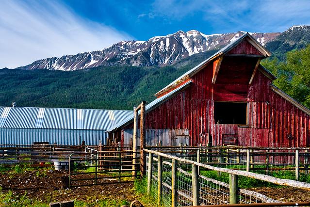 closeup of red western barn sunshine, Traverse Ridge, Ruby Peak, mountains, morning, Wallowa Valley, Wallowa county, Joseph, Oregon, spring