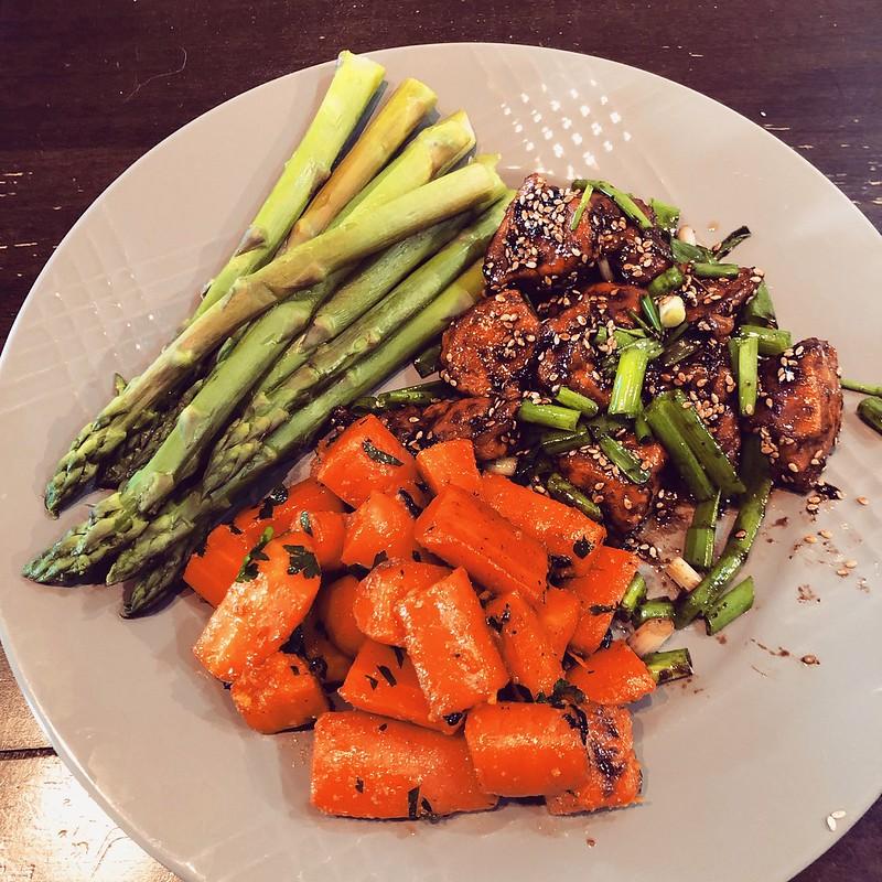 sesame chicken, ginger beer glazed carrots, and steamed asparagus