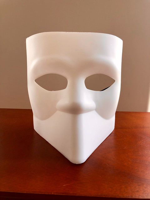 Creepy white mask