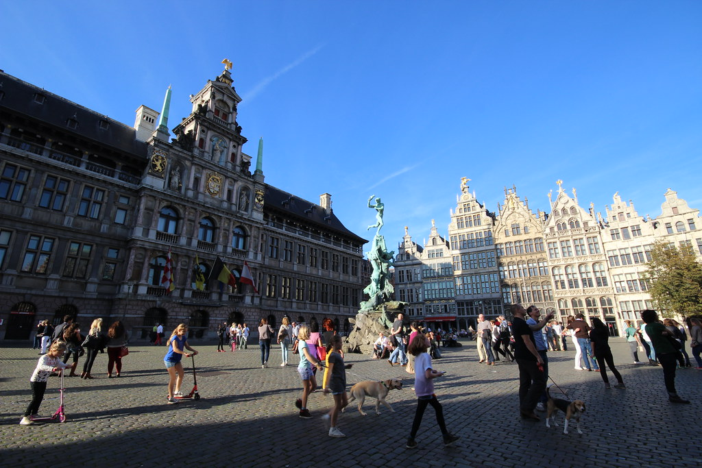 A photo of the town centre in Antwerp, with typical Belgium buildings: tall, with a triangle shapes roof and many windows