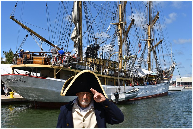 Erie's Maritime Museum Captain with the Picton Castle Ship in the background @ Erie, PA Tall Ships Festival 2019