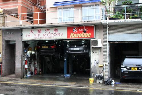Mechanics workshop on the ground floor of an apartment block on Bonham Road