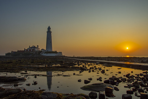 lighthouse stmarys stmaryslighthouse whitleybay northtyneside northumberland shipping safety sunrise dawn summer outdoors sea seaside landscape seascape nature photography colours colors rocks rock water sand land brick light sky