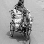 Rickshaw puller with Women