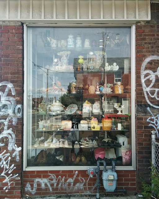 Window of bric-a-brac, Armstrong at Dufferin #toronto #wallaceemerson #dufferinstreet #armstrongavenue #window #ceramics #bricabrac #abandoned