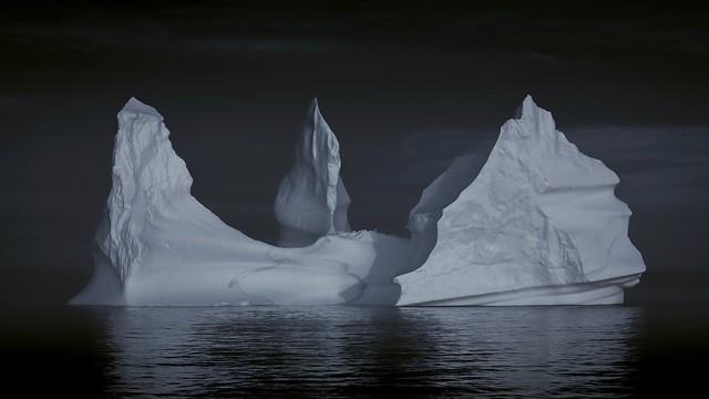 Giant iceberg cruising on the sea.