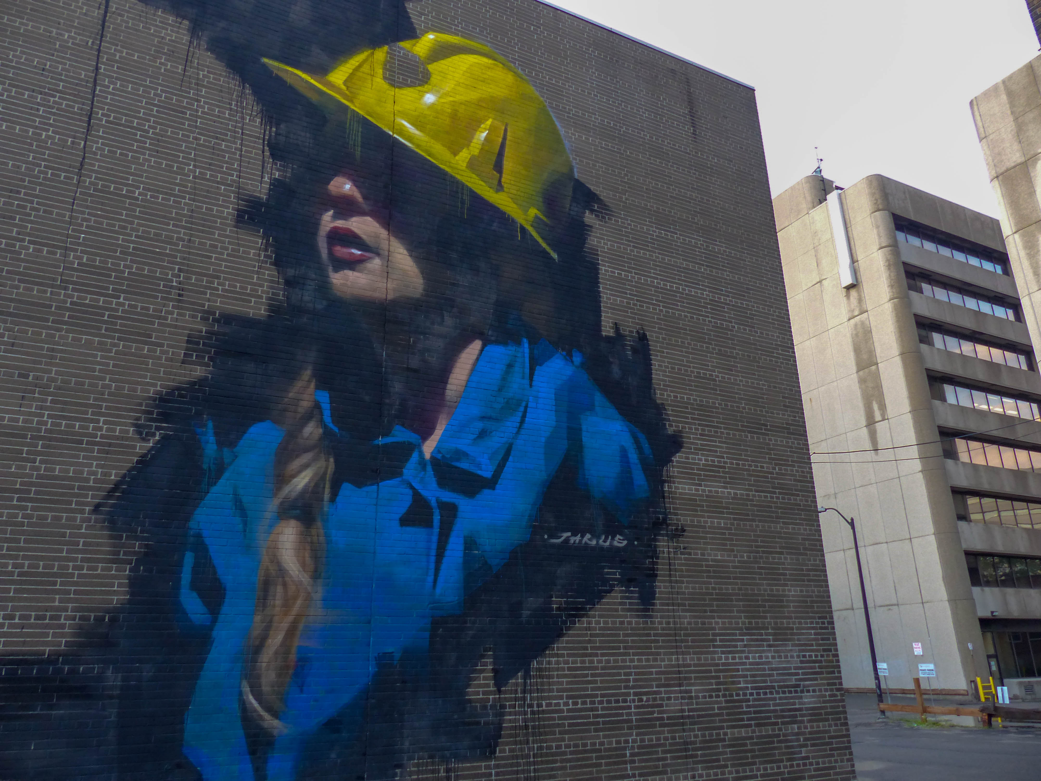 Downtown Sudbury mural of Dynamic Earth mine tour guide.