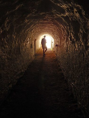 A silhouette against the light of an arched tunnel in Aalborghus Slot in Aalborg, Denmark