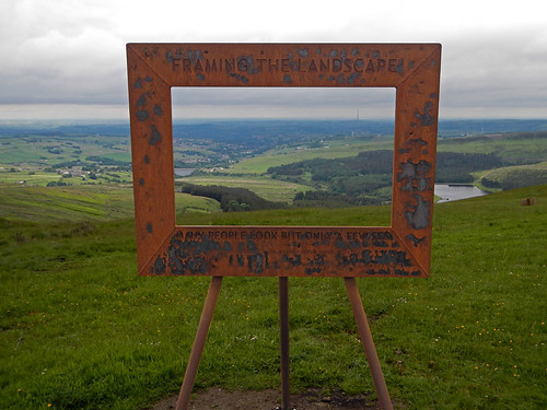 A rusty frame framing the English landscape of the Peak District of England