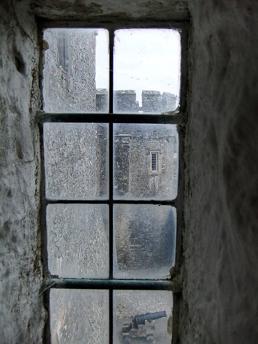 A view through the leaded glass window of Cahir Castle in Ireland