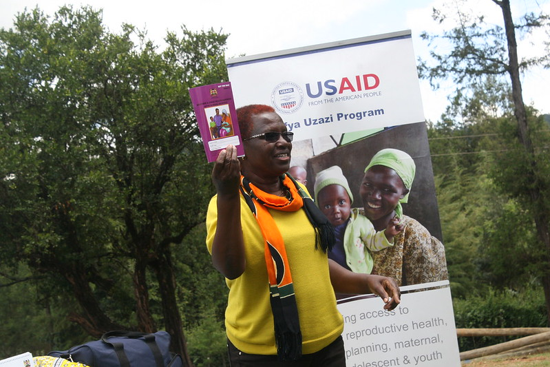 Afya Uzazi's Violet Ambundo emphasizes on the use the booklet to identify danger signs during pregnancy