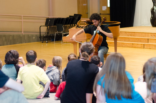 Cellist Nygel Witherspoon, 17, from Minneapolis, MN performs for students