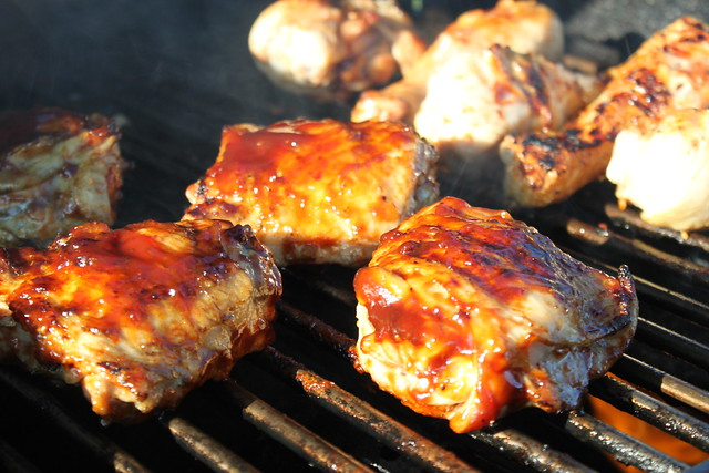 USDA Grade A cuts of chicken on a grill