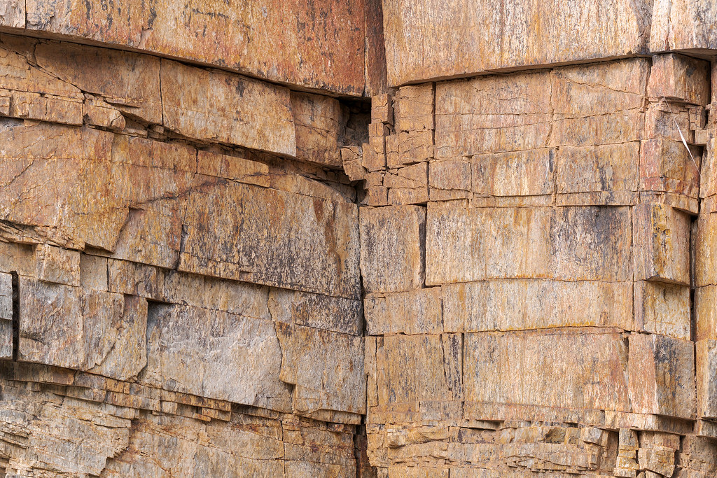 Close-up of horizontal and vertical cracks in a rock formation along the Quartz Trail in McDowell Sonoran Preserve in Scottsdale, Arizona in March 2019