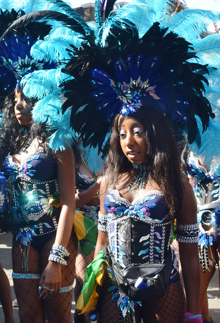 DSC_5697a Notting Hill Caribbean Carnival London Mas Players Parade Participant Performer Exotic Blue Colourful Showgirl Costume with Feather Headdress August 26 2019 Beautiful Stunning Girl