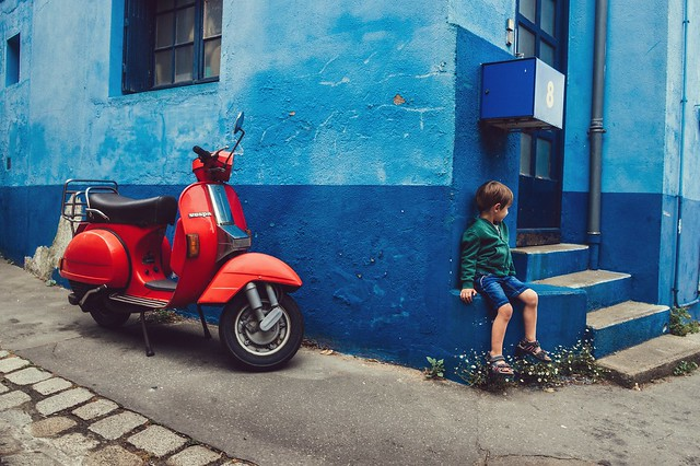 The red scooter and the little boy