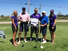 Harry Mussatto Golf Course  L-r: Alumni Director Amy Spelman '98, Dave Wickness '68 '69, Tom Tomaszewski '70 '72, Todd Sieben '67 and Associate Alumni Director Carrie Van Vleet '03