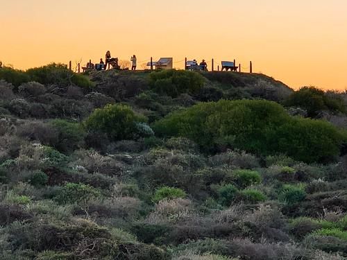 sunset kalbarri people lookout westernaustralia vegetation bushes seashore hill silhouette shadows uphigh australia