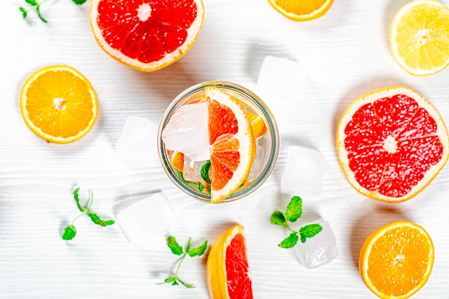 Top view, summer drink with ice cubes citrus slices and fresh mint