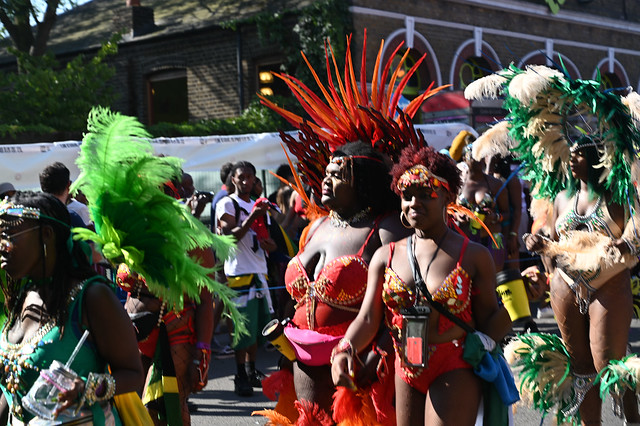 DSC_7196 Notting Hill Caribbean Carnival London Mas Players Parade Participant Performer Exotic Colourful Orange Showgirl Costume with Feather Headdress August 26 2019 Big Beautiful Woman BBW